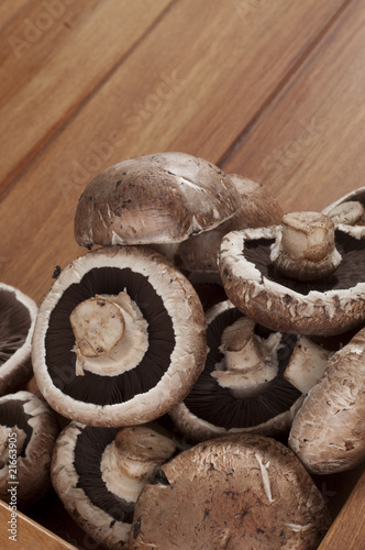 Group of brown mushrooms on brown tray