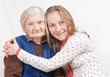The sweet young girl and the old woman staying together