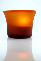 Orange Tea Light on White Background