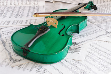 Green violin and music score