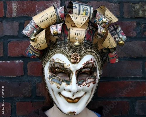 Girl wearing a venetian carnival mask (derisive gaze)