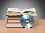open book  and DVD as symbols of old and new methods of informat poster