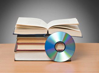 open book  and DVD as symbols of old and new methods of informat