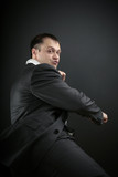 businessman shows his martial arts skills poster