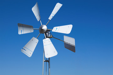Wind turbine, on blue background