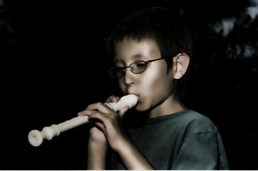 Stylized boy playing Recorder