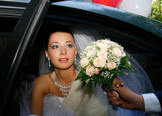 beautiful bride in the car