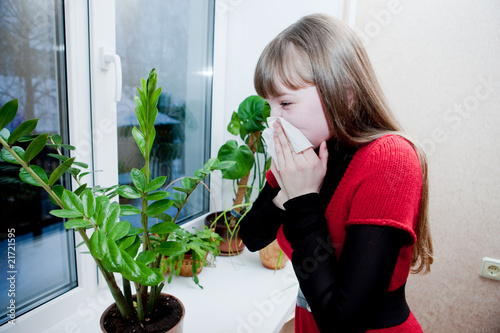 Girl blowing nose