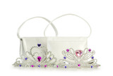 Woman bag and tiara isolated on the white background