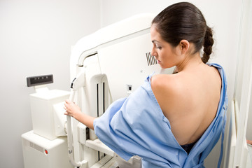 Woman having  a mammography scan
