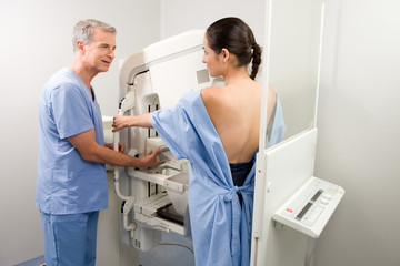Technician performing a mammography