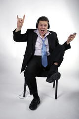 Businessman gone crazy listening to rock music
