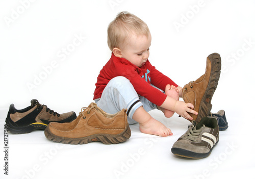 Baby and big shoes