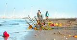 Burning joss sticks on  bank of Ganges river poster