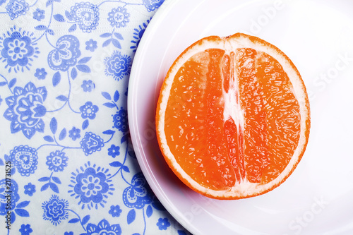 grapefruit on plate on napkin - 21731525