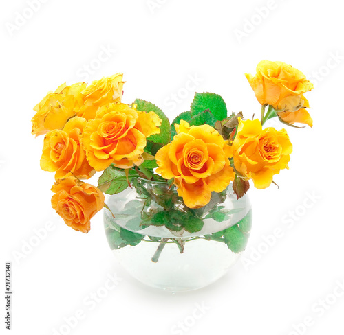 Bouquet of orange roses in a round vase