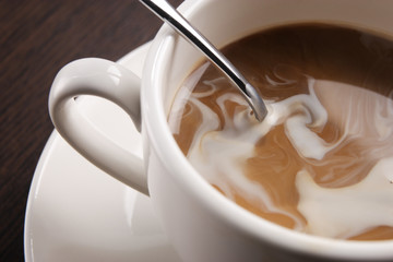 a cup coffee with cream swirl