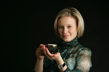 Portrait of the girl-blonde with a glass in hand