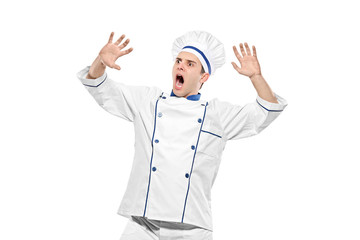 Stunned chef isolated on white background