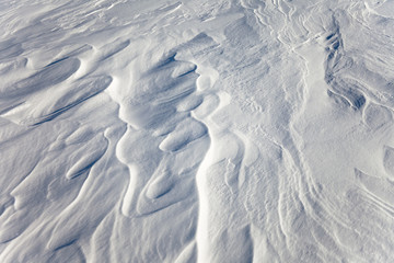 windblown snow surface, background pattern
