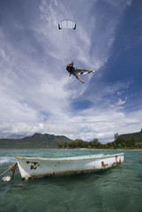 kiter's jump over a boat