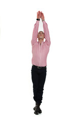 dancer holding arms high above his head