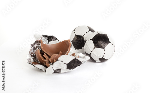Little chocolate footballs on a white background