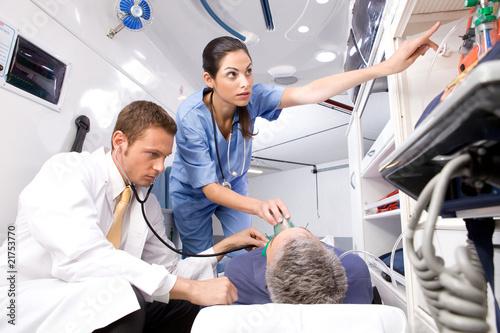 Nurse putting an oxygen mask