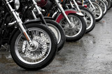 gathering of motorcycles on a rainy day poster