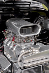 supercharger under the hood of a performance car