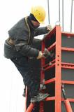 construction worker assembling formwork poster