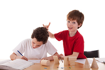 two students in the classroom, making ugly gestures