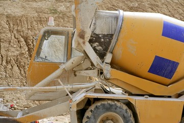 Concrete mixer truck detail in yellow with blue stripes