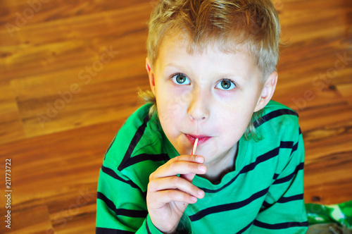 cute little boy with lollipop