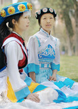 Chinese women in traditional clothes of the Naxi minority