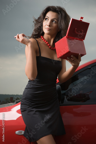 Woman with cosmetic bag in hands