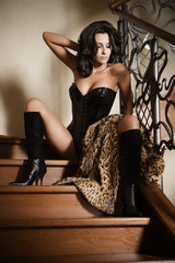 Girl dressed in corset and leopardic fur
