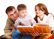 Parents reading to their kid