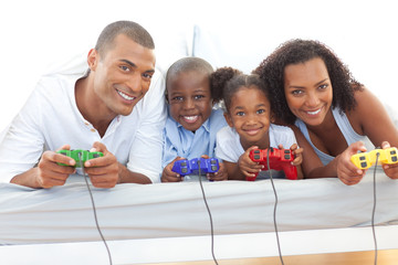 Animated family playing video game lying down on bed