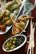 Antipasti platter, scampi and olives; grissini