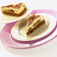 Two pieces of tiramisu cake