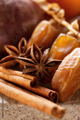 Still life with dates, star anise and cinnamon sticks
