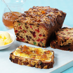 Fruit cake with butter and jam