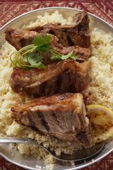 Grilled lamb chops on couscous (N. Africa)