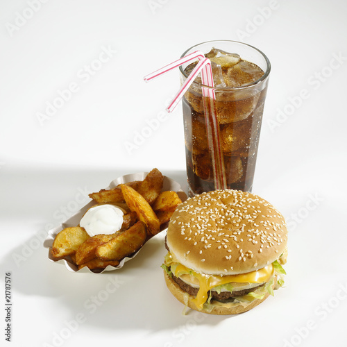 Cheeseburger, potato wedges and cola