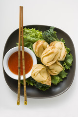 Deep-fried wontons with sweet and sour sauce