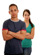 Unhappy teenage couple over white background