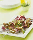 Lamb and onion kebabs with lime wedges