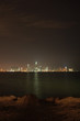 The night skyline over the persian gulf of the city of Doha