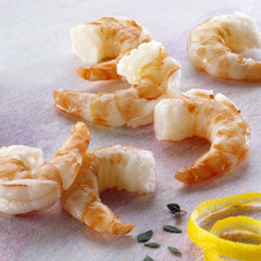 Several shrimp tails, thyme and lemon rind